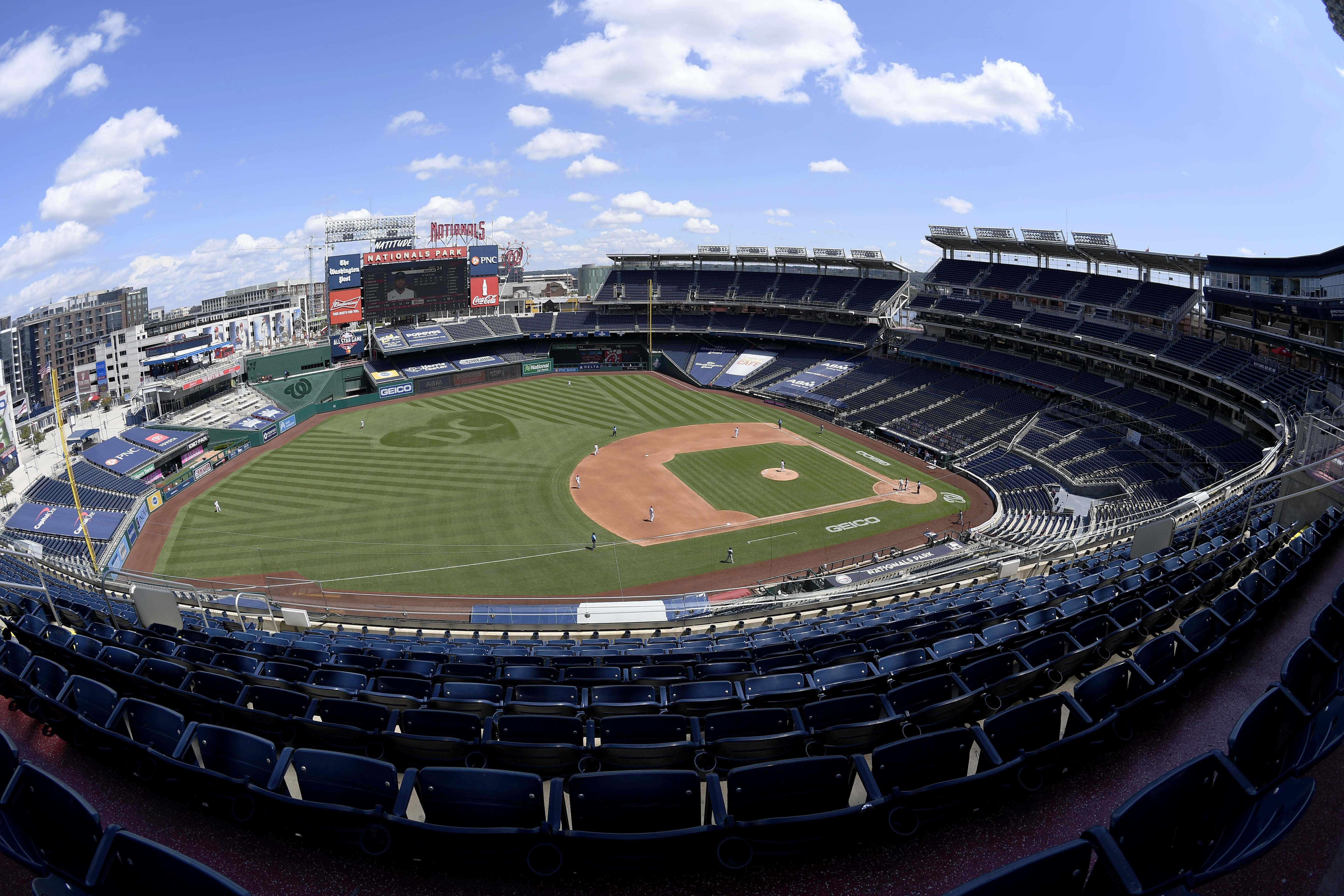 In this photograph taken with a fisheye lens, the Washington Nationals and the Miami Marlinsm compete during the fourth inning of a baseball game, Sunday, Aug. 23, 2020, in Washington. (AP Photo/Nick Wass)