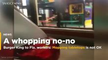 Burger King employee filmed cleaning tables with mop used on the floor