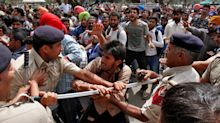 Student scuffles with policemen during protests in India and more: April 6 in photos