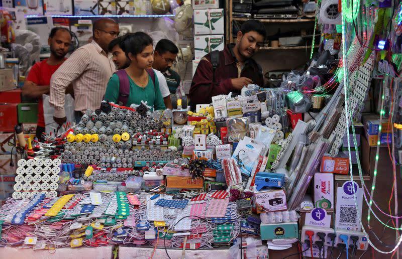 People buy electric goods at a roadside market in Kolkata