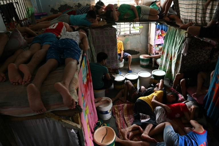 Charities warn a proposed bill to lower the age of criminal responsibility from 15 to 12 in the Philippines, will mean thousands more children will be sent to overcrowded and underfunded centres -- leaving them vulnerable to mistreatment (AFP Photo/TED ALJIBE)