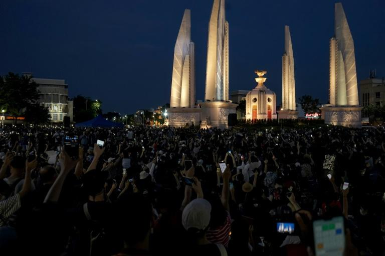 Thousands of mostly young, black-clad protesters amassed at Bangkok's Democracy Monument in one of the city's largest shows of defiance in years (AFP Photo/Aidan JONES)