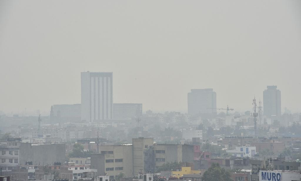 Partial view of Mexico City covered in smog on May 3, 2016