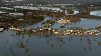 Heavy rains and strong winds cause flooding in parts of Britain