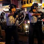 Shot fired and water cannon deployed as police and protesters clash in Hong Kong's Western New Territories
