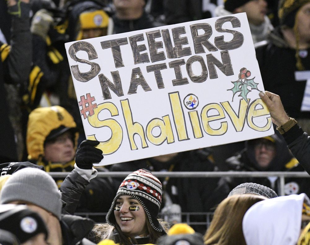 Pittsburgh Steelers fans hold a sign supporting injured Steelers linebacker Ryan Shazier. (AP)