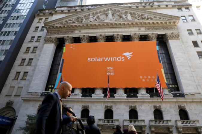 FILE PHOTO: SolarWinds Corp. banner hangs on the company's IPO at the NYSE in New York