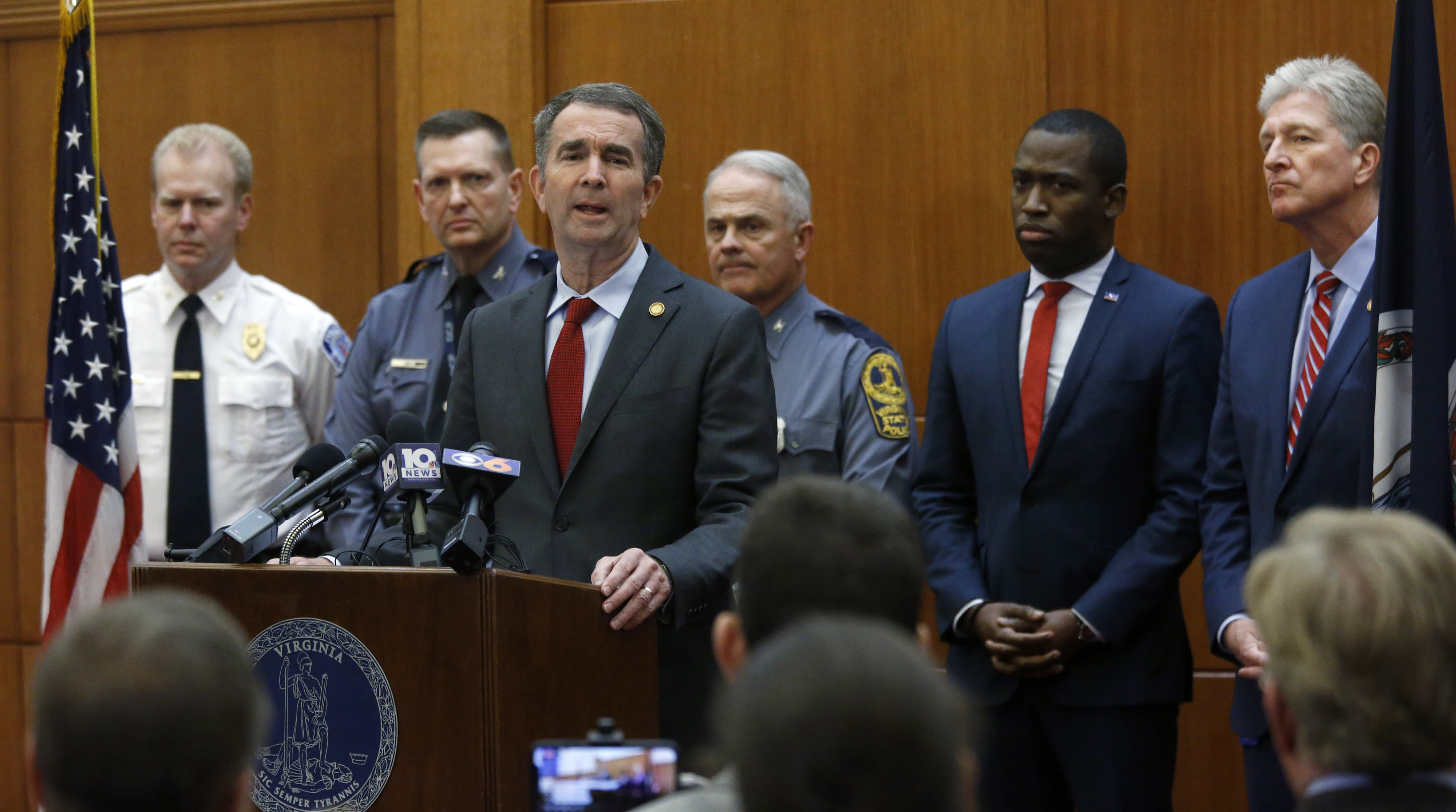 FILE - In this Wednesday, Jan. 15, 2020 file photo, Gov. Ralph Northam talks about security plans for Lobby Day at the Capitol when large crowds are expected to arrive at Capitol Square, during a news conference at the Patrick Henry Building in Richmond, Va. On Friday, Jan. 17, 2020, The Associated Press reported on stories circulating online incorrectly asserting that Northam said if people don't give up guns, the National Guard will cut off their power, and have them killed. Northam has responded to the false claim, saying he has no plans to confiscate guns. (Bob Brown/Richmond Times-Dispatch via AP)
