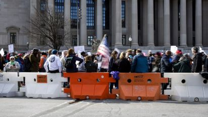 Students march to demand stricter gun laws