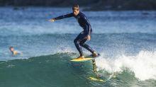 Kai Lenny shows Steve Aoki how to ride a hydrofoil surfboard