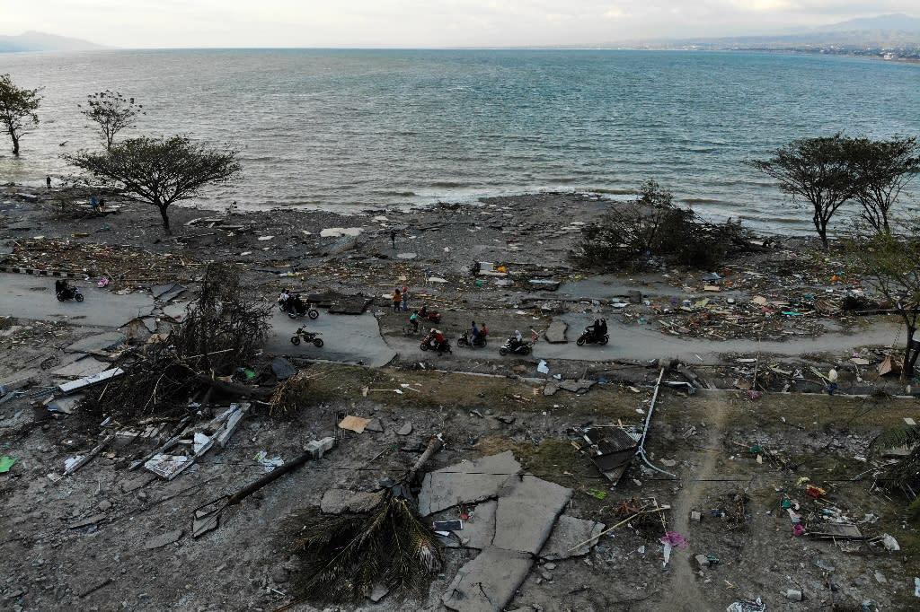 The tsunami crashed into the seaside city of Palu (AFP Photo/Jewel SAMAD)