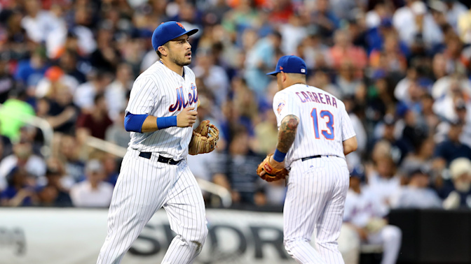 Mets rotate infielders 22 times after catcher is forced to play third base