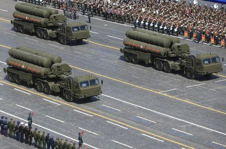 RuRussian S-400 Triumph/SA-21 Growler medium-range and long-range surface-to-air missile systems drive during the Victory Day parade at Red Square in Moscow