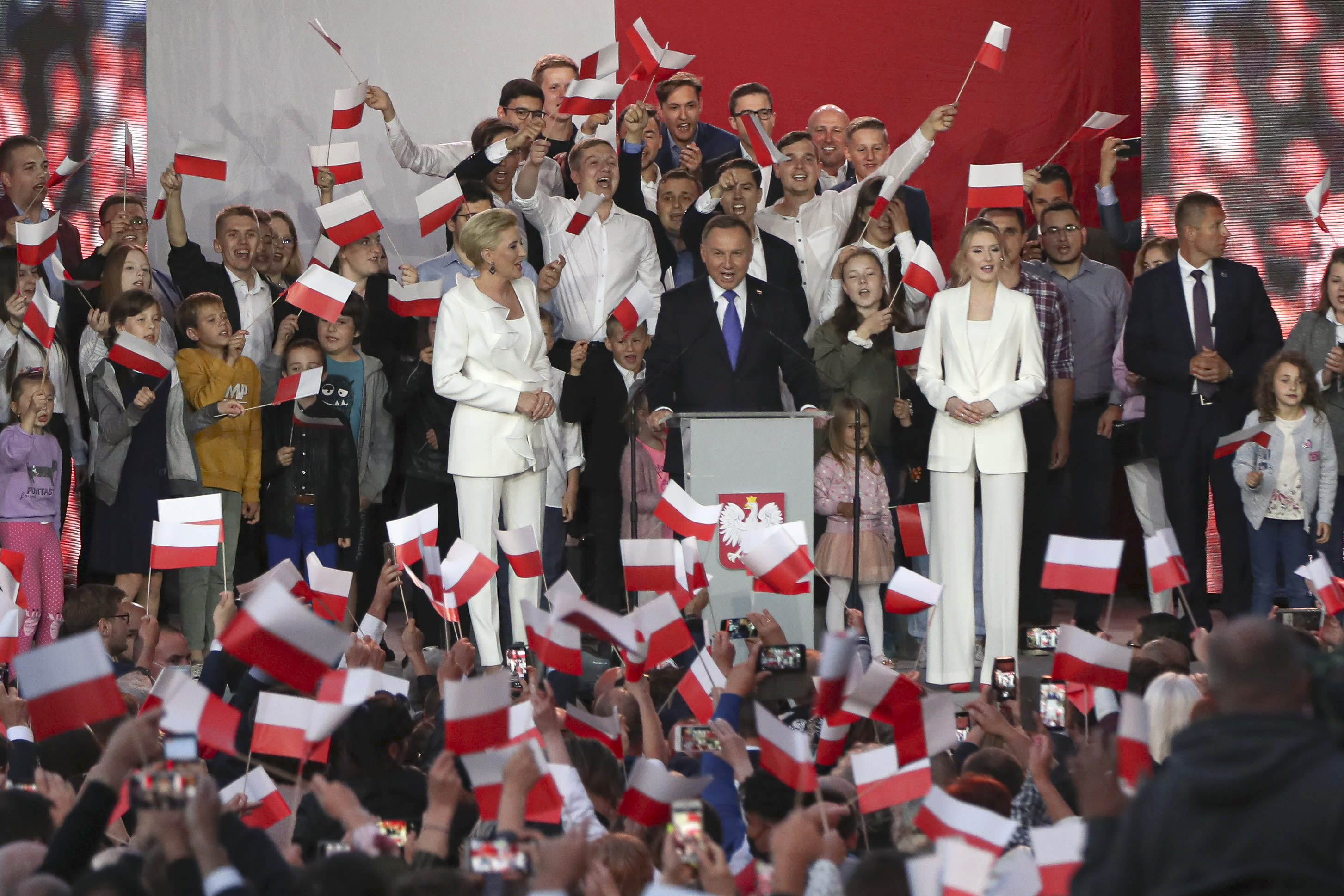Incumbent President Andrzej Duda addresses supporters in Pultusk, Poland, Sunday, July 12, 2020. An exit poll in Poland's presidential runoff election shows a tight race that is too close to call between the conservative incumbent, Andrzej Duda, and the liberal Warsaw mayor, Rafal Trzaskowski. (AP Photo/Czarek Sokolowski)
