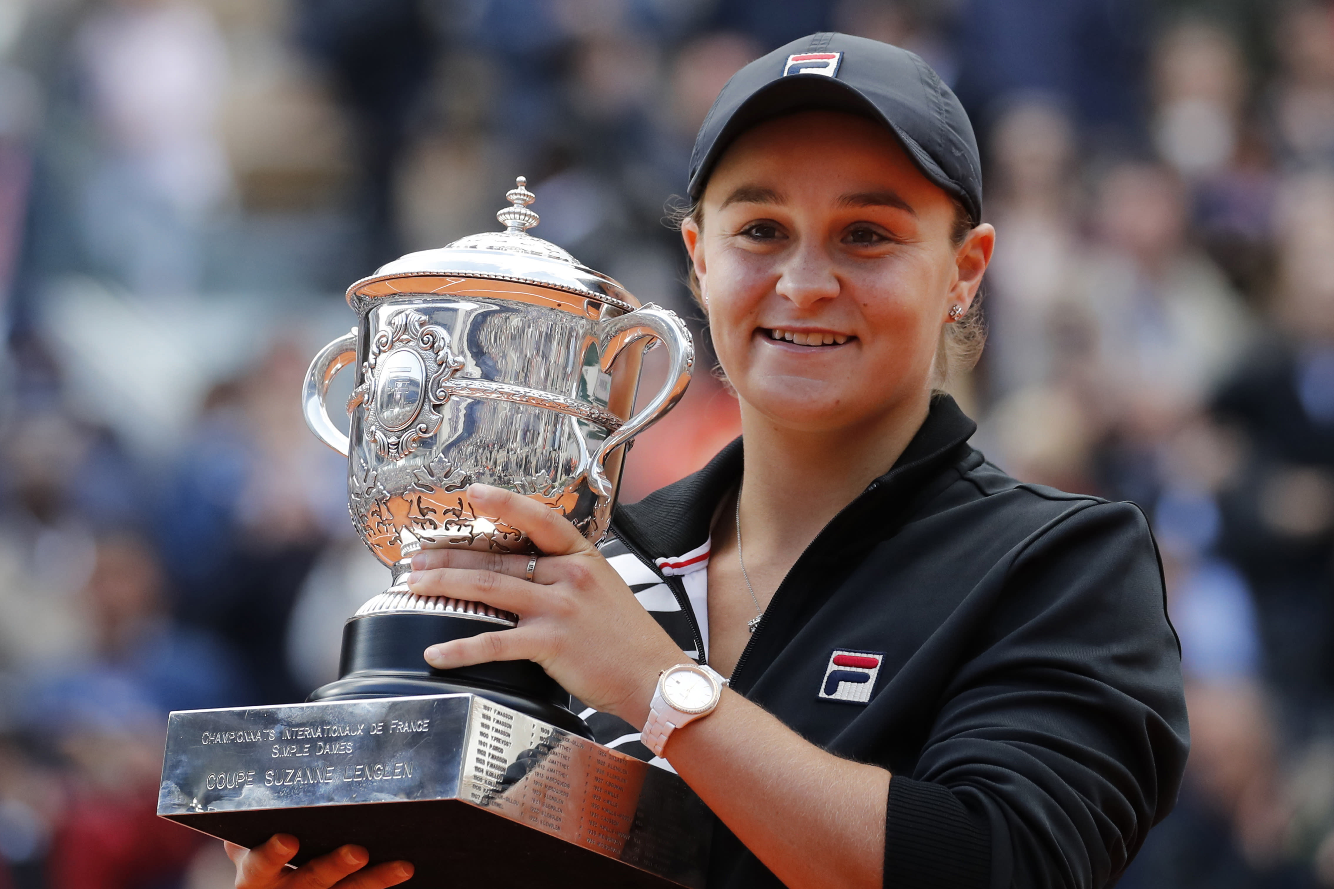 FILE - In this June 8, 2019, file photo, Australia's Ash Barty holds the trophy as she celebrates winning her women's final match of the French Open tennis tournament against Marketa Vondrousova of the Czech Republic in two sets 6-1, 6-3, at the Roland Garros stadium in Paris. Top-ranked Ash Barty has withdrawn from the U.S. Open because she is not comfortable with traveling during the coronavirus pandemic. (AP Photo/Christophe Ena, File)