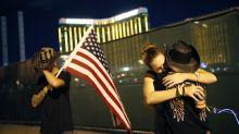 Dimmed lights, somber tributes on Vegas shooting anniversary