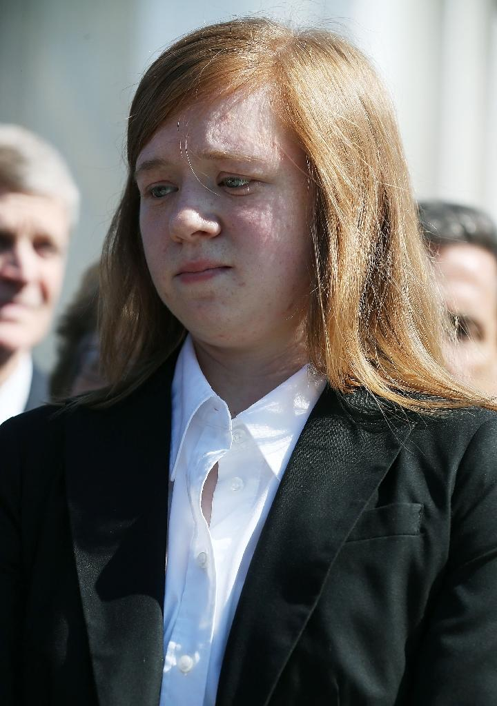 Plaintiff Abigail Fisher speaks to the media after US Supreme Court heard arguments in her case on October 10, 2012 in Washington, DC (AFP Photo/Mark Wilson)