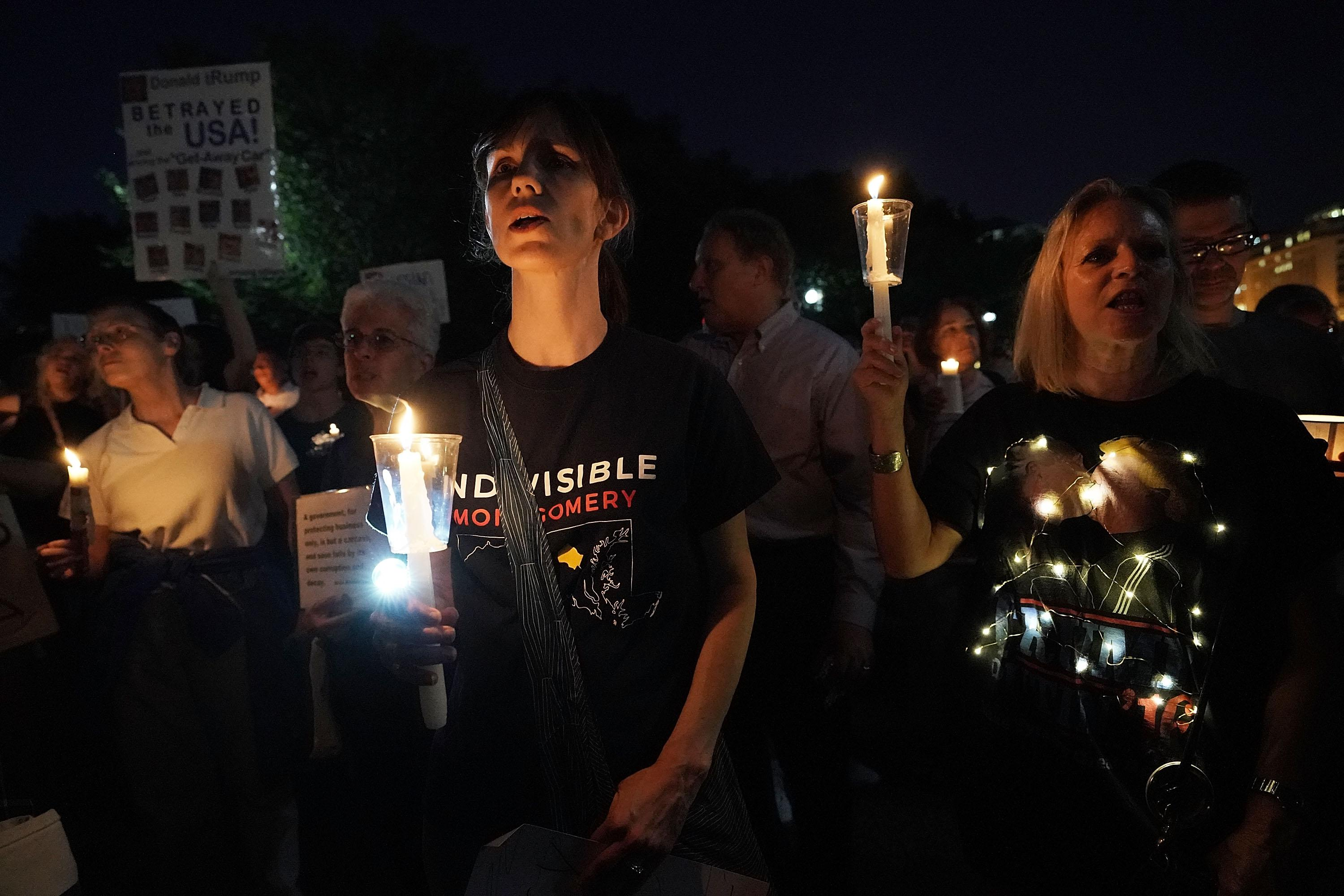 <p>Activists participate in a vigil in front of the White House on July 18, 2018, in Washington, D.C. (Photo: Alex Wong/Getty Images) </p>