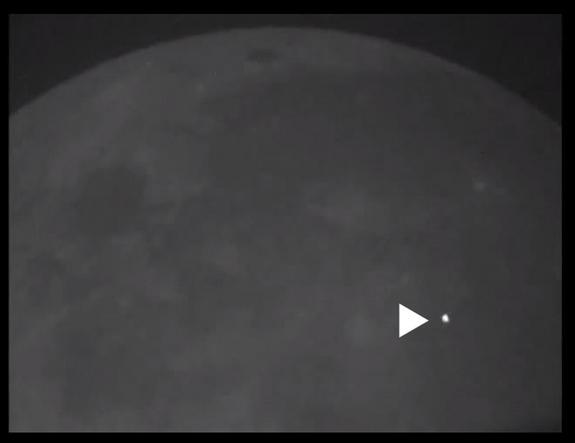 This photo shows the bright flash of the light that resulted from a huge boulder slamming into the moon's surface March 17, 2013.
