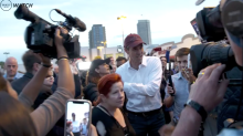 Beto O'Rourke hits early polling place in Houston, holds mini-rally ahead of Trump's huge rally
