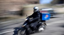 Domino's scraps dividend, sees hike in delivery demand