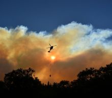 Firefighters battle blazes on two fronts in California, 44 dead