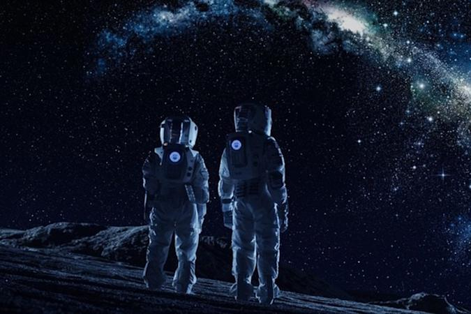 Astronauts on the Moon in darkness