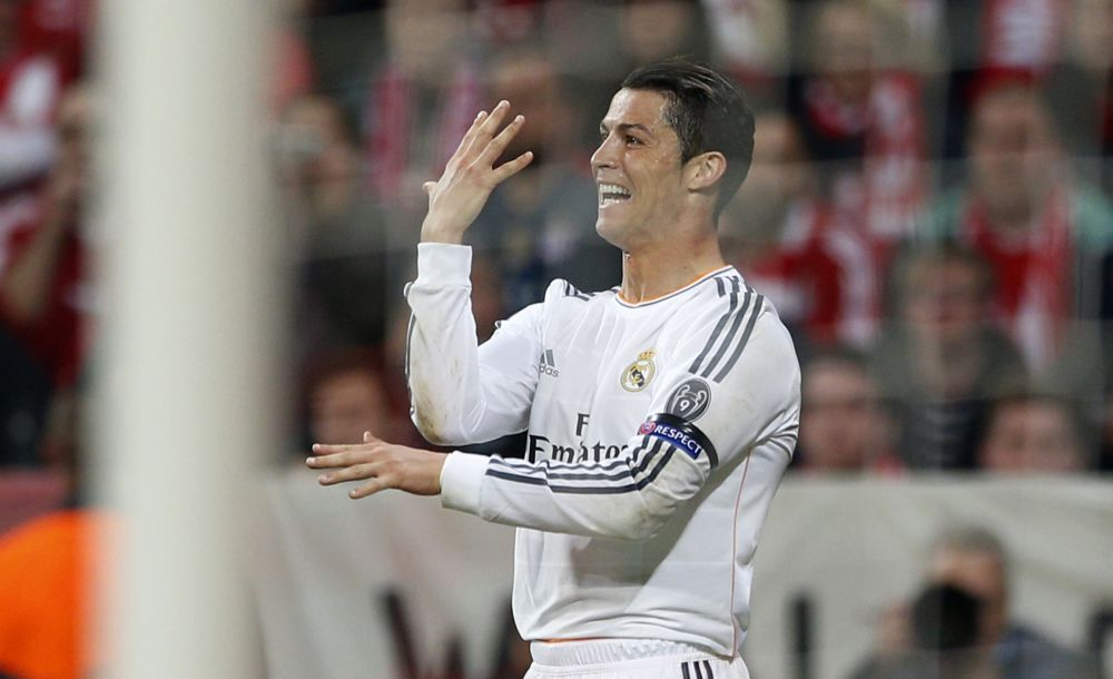 Real's Cristiano Ronaldo celebrates scoring his side's 3rd goal during the Champions League semifinal second leg soccer match between Bayern Munich and Real Madrid at the Allianz Arena in Munich, southern Germany, Tuesday, April 29, 2014
