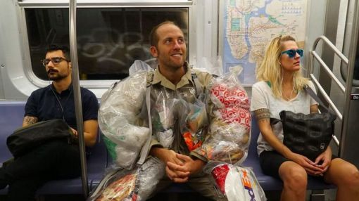 Activist wears month's worth of trash to visualize our wasteful habits