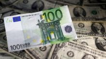 Dollar dips, euro higher after PMI data