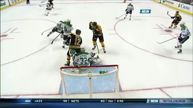 Milan Lucic tips in a Dougie Hamilton shot