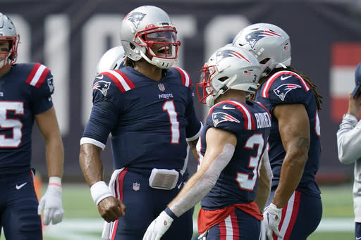 New England Patriots quarterback Cam Newton (1) gives a shout as the team warms up before an NFL football game against the Las Vegas Raiders, Sunday, Sept. 27, 2020, in Foxborough, Mass. (AP Photo/Charles Krupa)