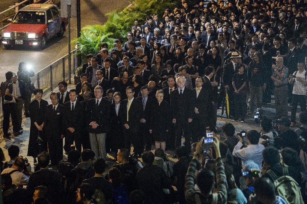 Lawyers protest at a ruling by China which effectively bars two pro-independence legislators from taking office in Hong Kong, on November 8, 2016 (AFP Photo/Anthony Wallace)