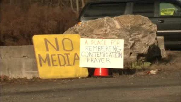 Newtown grows weary of media, visitors