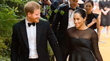 Meghan Markle and Prince Harry 'break dinner party etiquette by insisting on sitting next to each other'