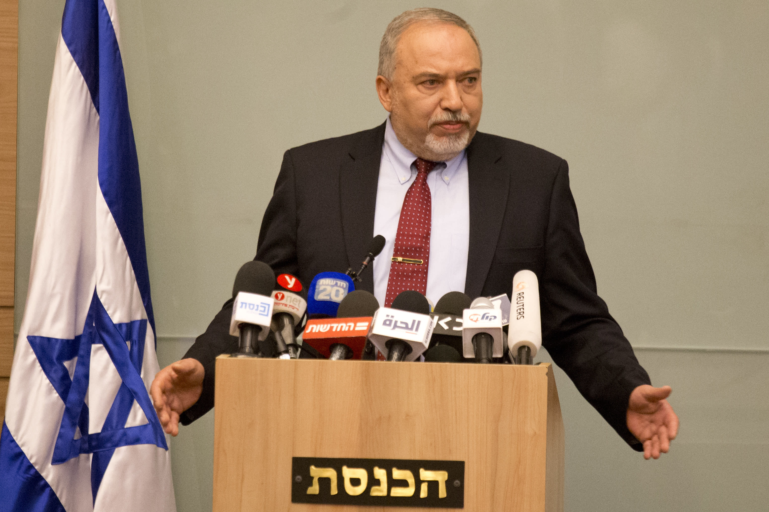 Israeli Defense Minister Avigdor Lieberman delivers a statement at the Knesset, Israel's Parliament, in Jerusalem, Wednesday, Nov. 14, 2018. Lieberman announced his resignation Wednesday over the Gaza cease-fire, making early elections likely. (AP Photo/Ariel Schalit)