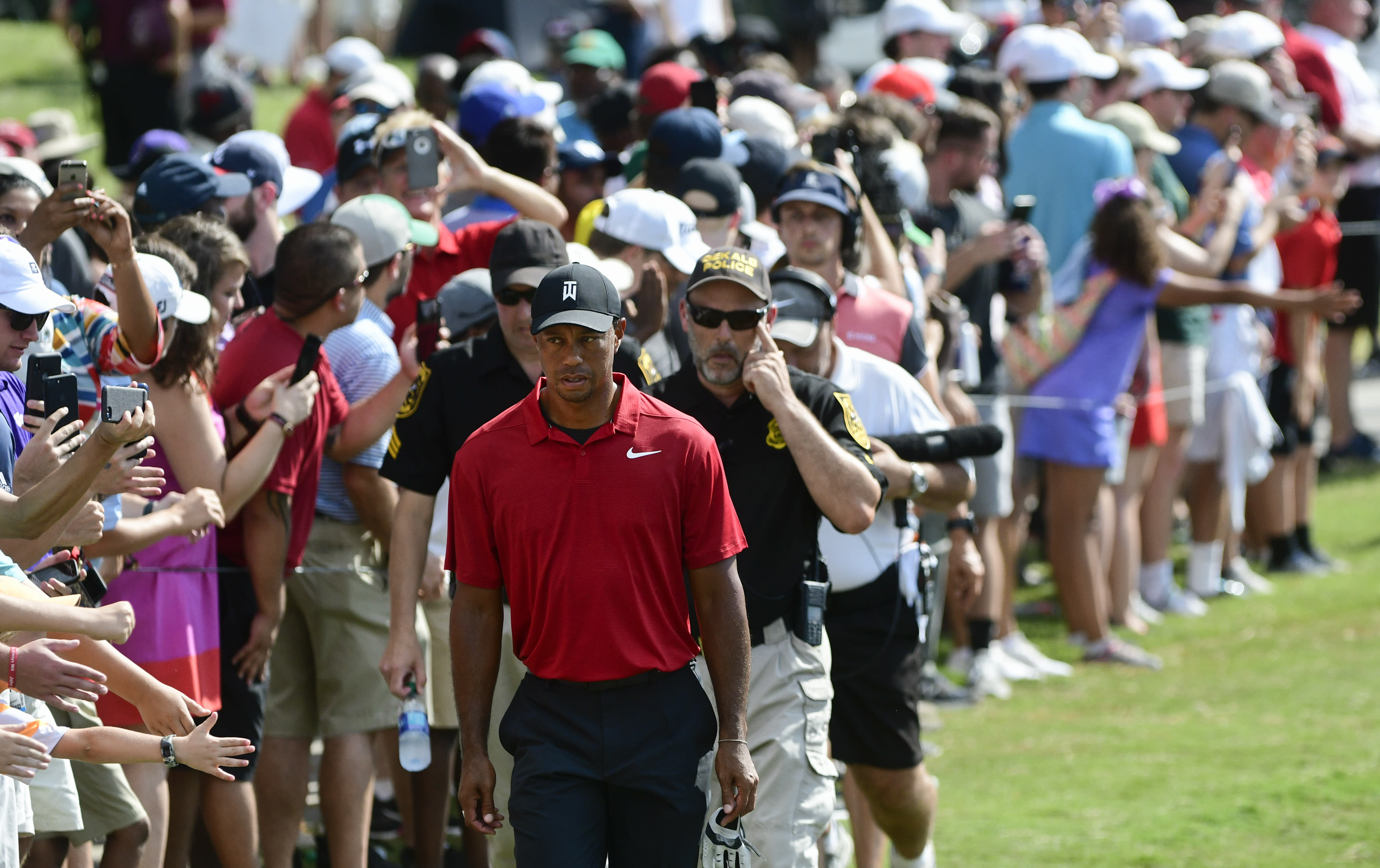 The Latest: Woods a winner again for 1st time since 2013