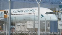 Cathay Pacific expects lower first-half loss on cost savings, cargo flights
