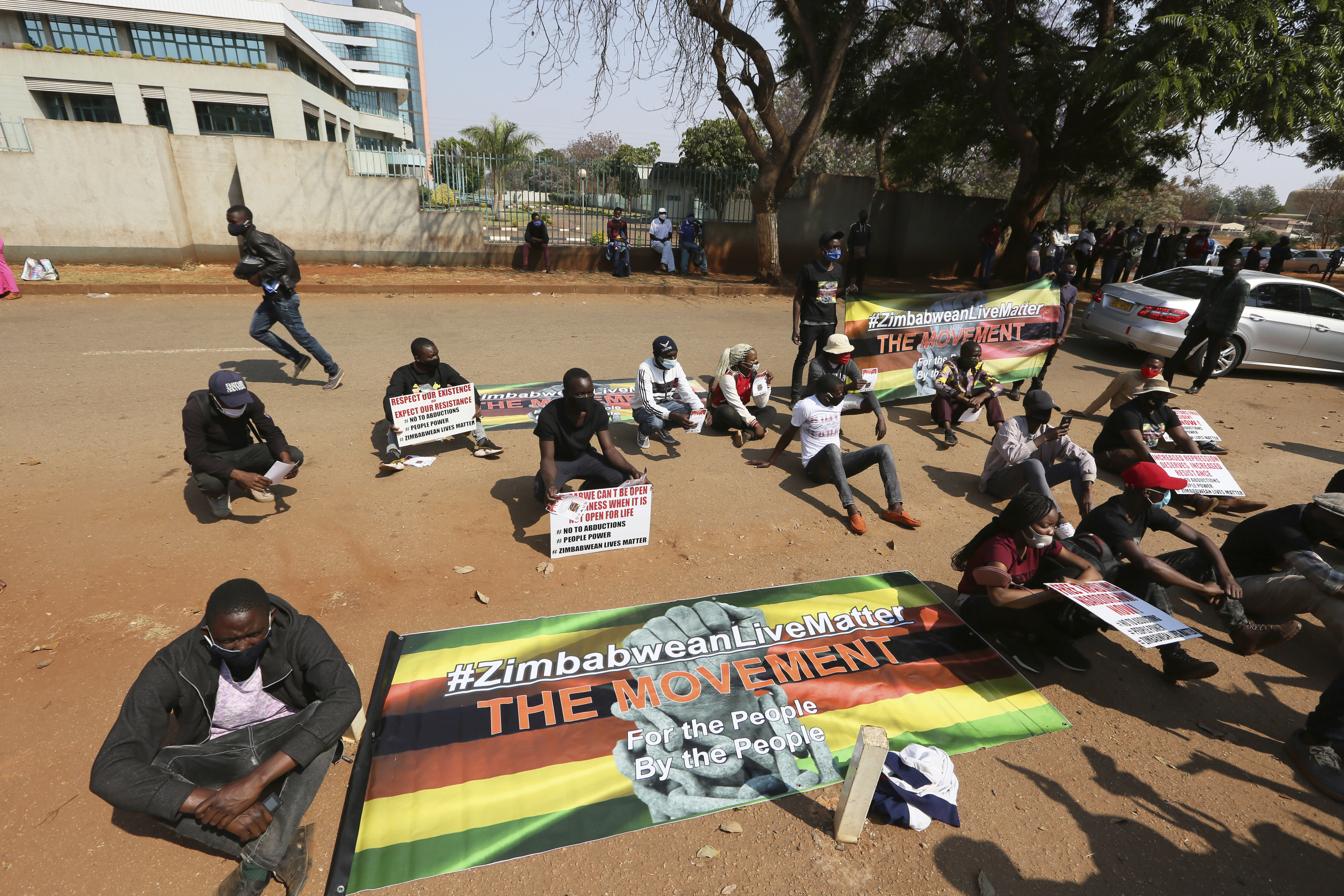 Students and human rights activists take part in a peaceful protest in Harare, Monday, Sept. 14, 2020. Human rights defenders say it appears the government is using restrictions imposed to combat COVID-19 to suppress political criticism. Opposition officials, human rights groups and some analysts accuse Mnangagwa of abusing the rights of critics, using tactics as harsh as his predecessor, the late Robert Mugabe. (AP Photo/Tsvangirayi Mukwazhi)