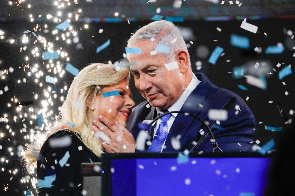 Israeli Prime Minister Benjamin Netanyahu embraces his wife Sara as his right-wing Likud party celebrates victory, at least on paper, in the April 9 general election