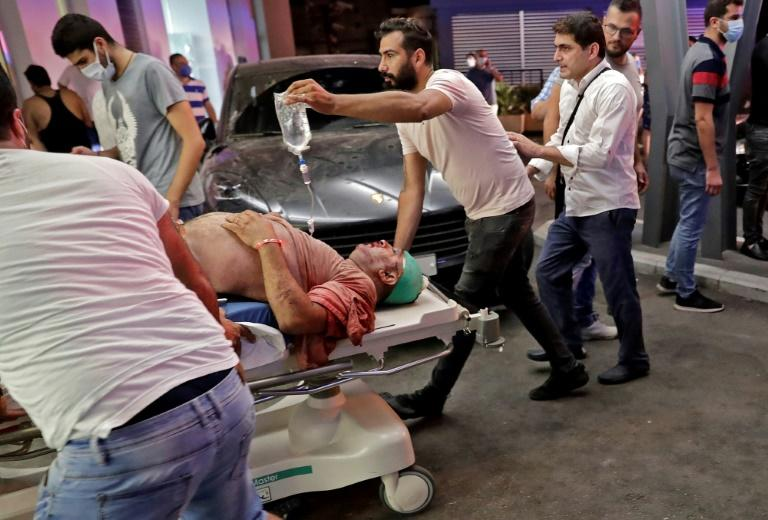More than 4,000 wounded people staggered or were taken into damaged and overwhelmed hospitals across the Lebanese capital on Tuesday evening (AFP Photo/IBRAHIM AMRO)