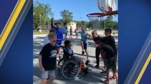 Heartwarming video shows students helping classmate in wheelchair play basketball: 'Some lessons can't be taught'