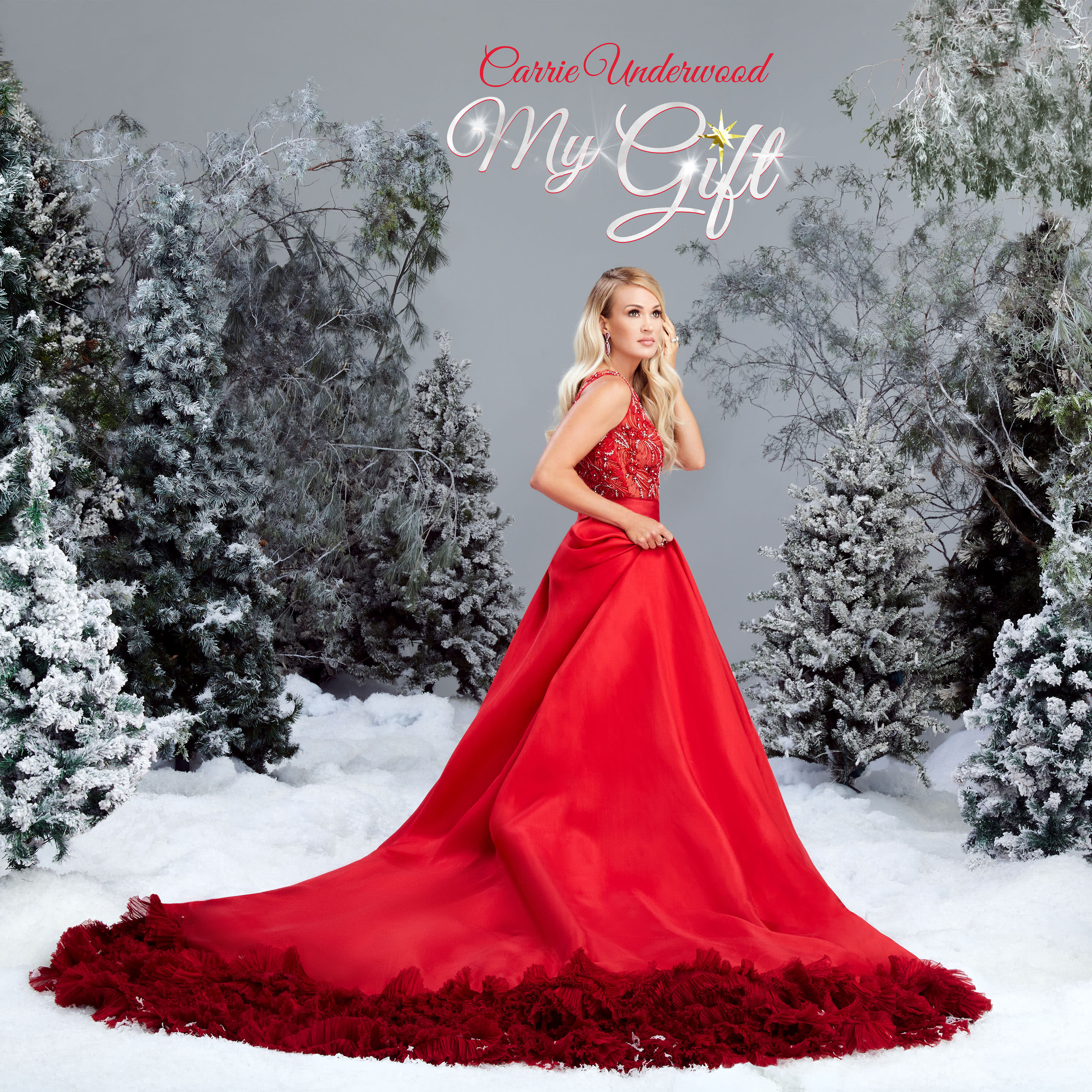 "This image provided by Universal Music Group Nashville shows the cover of ""My Gift"" the newest Christmas album by Carrie Underwood. Underwood's 5-year-old son provided the adorable vocals on ""Little Drummer Boy,"" one of the 11 tracks on the country superstar's new Christmas album, out Friday, Sept. 25, 2020. (Joseph Llanes/Universal Music Group Nashville via AP)"