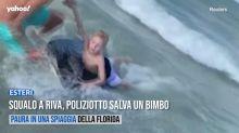 Squalo a riva, poliziotto salva un bimbo