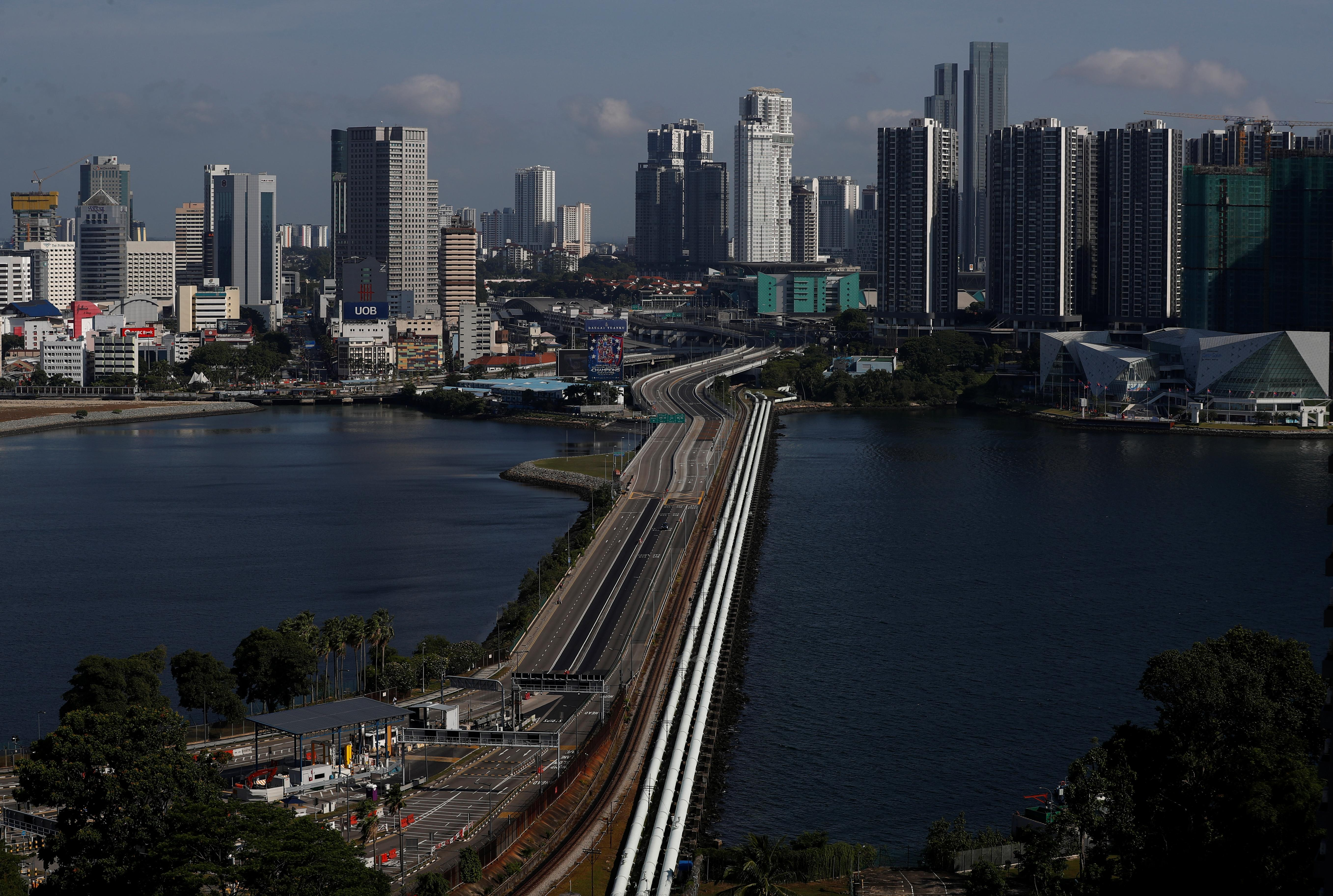 Malaysia looking to reopen border with Singapore in January: report