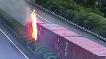 Chinese driver jumps out of truck to escape after the vehicle crashes into central reservation and catches fire