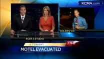 Fast-moving grass fire spreads to Fairfield Motel 6