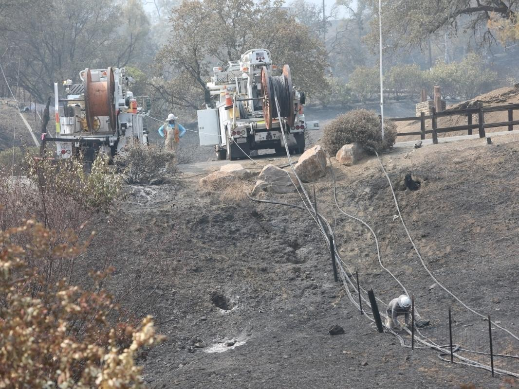 Crews work in Napa County to re-establish utility and cable services.