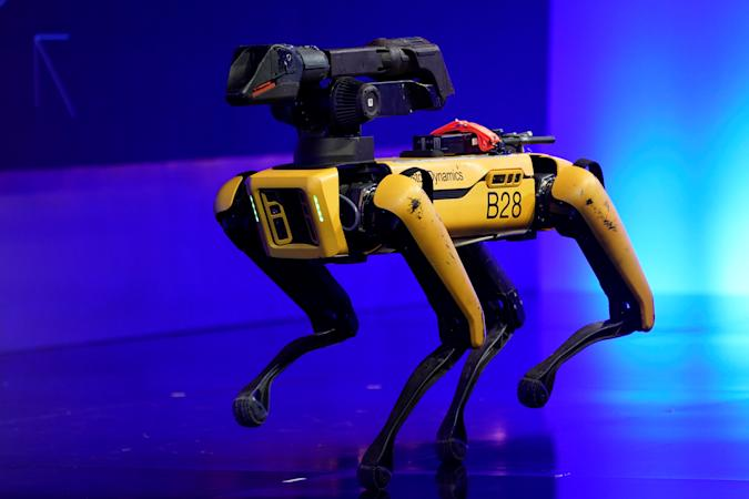 A robot from Boston Dynamics walks around the stage at the WSJTECH live conference in Laguna Beach, California, U.S. October 21, 2019.    REUTERS/ Mike Blake