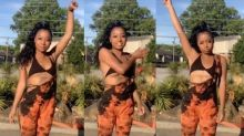 Dancing girl gets video-bombed by neighbour